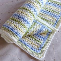 A very simple striped V-Stitch blanket, with sample chart to show colour pattern, stitches and border.