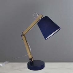 Crafted from metal and natural wood making it modern and durable in design, this desk lamp is perfect for a child's bedroom. Painted in a classic navy it is sui. Task Lamps, Natural Wood, Table Lamp, Lighting, Metal, Modern, Design, Home Decor, Navy