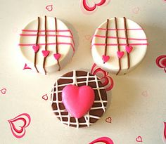Chocolate covered *Oreos*. Quite easy to do and pretty for a Valentine sweet table or gifts.