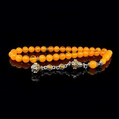 Orange Amber Tasbih With 925 Sterling Silver Tassle Orange Amber Tasbih With 925 Sterling Silver Tassle. 33 Pieces 10 MM x 10 MM round Cut Orange Amber Beads Used On Tasbeeh.  Specifications of Tasbeeh: Beads Type: Amber Beads Color: Orange Tassle Type: 925 Sterling Silver Count of Beads: 33 Pieces of Amber Beads Dimensions of Beads: 10 MM x 10 MM Lenght of Beads: 21 cm Lenght of Tassle: 10 cm Total Lenght of Tasbih: 31 cm  Made in Istanbul Turkey with famous Ottoman Style Hand Made Tasbeeh…