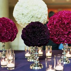 Love this. Pomanders like these are actually easy to make yourself... Carnations stuck into styrofoam balls & placed on candleholders! Beautiful!!