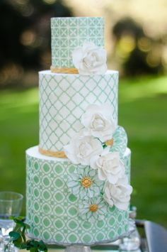 My favorite part of creating themed cakes is just tiptoeing around the concept rather than being too literal. So with this one I used a traditional quatrefoil pattern that reminded me of four leaf clovers and stuck with a simple green, white & gold color palette. The bold modern geometrics were softened by the the rice paper pinwheels and gumpaste gardenias.