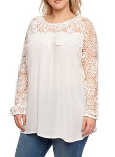 Take a vintage-inspired approach to dressing with this easy crochet-trimmed top. Featuring a relaxed fit and pinwheel crochet trim at the yokes and sleeves, this flattering top defines bohemian polish. Style this top with skinny jeans and platform sandals for a retro finish.