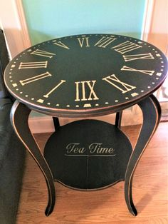 "Antique oak tea table painted in Annie Sloan Graphite with black wax, no clear wax. Stencilled Clock face and ""tea time"" using  light gold metallic paint (water based). Finished flat surfaces with 3 coats matte polyacrylic. Love it!"
