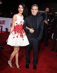Amal Clooney joined her husband, George, at the Hail, Caesar! premiere in California wearing a floral appliqué Giambattista Valli minidress