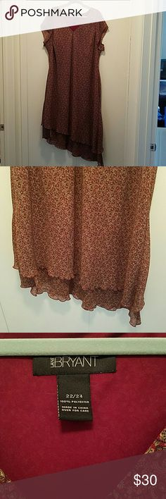 Lane Bryant Paisley Print Dress EUC Short-sleeved dress with a slanted hem. The dress is lined.  Armpit to armpit 25 in Length Shoulder to hem 48 in Size 22/24 Dominant color is burgundy Lane Bryant Dresses Midi
