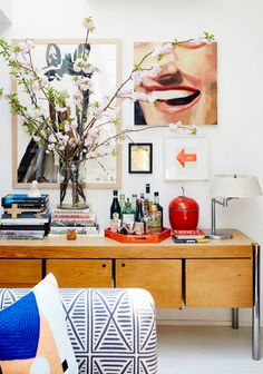 Living space with a well-styled vignette with pop art and a large plant
