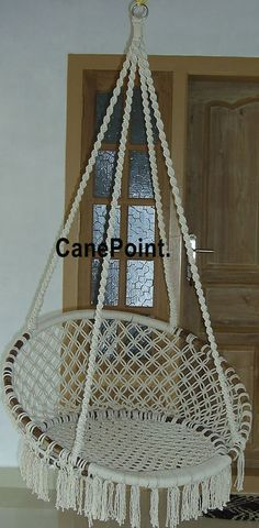 I pinned hanging chair options for bedroom, but none seem quite right. This one would obviously have to lose the fringe...