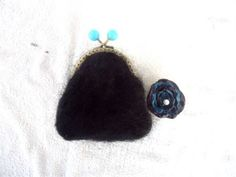 This hand knitted black fluffy yarn coin purse with the optional detachable blue and black singe flower brooch which could be worn on your hat, handbag, lapel or leave on the purse would make a lovely gift for - sister, auntie, mother or niece with the turquoise bobbles and matching lining it will surely be a hit.  All items in my shop are made and READY TO SHIP ...... you will receive the item in the photos  CONTENTS NOT INCLUDED IN THE PRICE   Measurements are approximately:  Width at base…