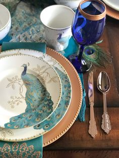 Copper, Teal and Cobalt Colored Peacock Table Setting for a peacock wedding theme (or holiday tablescape)/ peacock dinnerware - the perfect choice for a wedding registry / diy gold rimmed wine glasses / as seen on Brenda's Wedding Blog www.brendasweddingblog.com / design and styling by Bri of Halfpint Design
