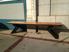 angle bench made out of reclaimed wood and reclaimed Ibeams