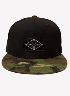 5c08ab3ef942f1 Mens snapback with camo brim and patch sewn on front. Available at  www.sinkorswimbrand.com