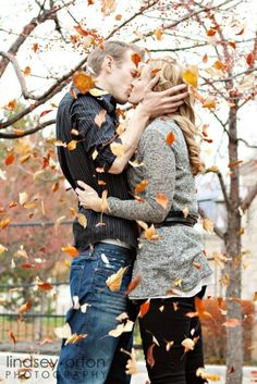 kissing with leaves falling all around
