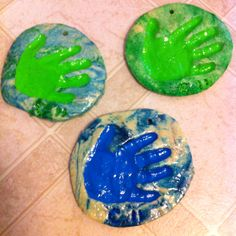Our salt dough hand prints.  Four cups flour, one cup salt, one and a half cups water, 1/3 cups vegetable oil.  Kneed until play dough consistency, add dye for marble look while kneading.  Roll out and make whatever shape or design you want.  Poke a lot of little holes all over to avoid bubbling from air in the dough.  Bake on 300 on foil lined cookie sheet for about 45 minutes give or take depending on size a d thickness.  After they are hardened paint if desired with acrylic paints then…