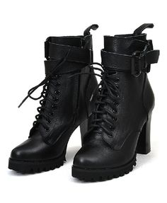 Featuring soft leather upper with lace up detail to front, zip closure to inner side, wrapped pin buckle belt to cuffs, a deep tread sole with a chunky heel, in a punk style.