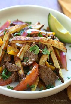 I put a healthier spin on Lomo Saltado (Peruvian Beef Stir Fry) one of my favorite Peruvian dishes! Peruvian Dishes, Peruvian Cuisine, Peruvian Recipes, Stir Fry Dishes, Beef Dishes, Beef Recipes, Cooking Recipes, Healthy Recipes, Sauce Recipes