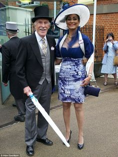 Ready for the rain: Sir Bruce Forsyth and his wife Lady Wilnelia at Royal Ascot.