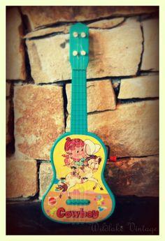 Vintage Toy Guitar. $12.00, via Etsy.