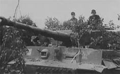 """Behind the scenes"" footage with Michael Wittmann in Normandy taken after he was awarded Swords to his Knight's Cross for his action on 13 June 1944, near Villers-Bocage, where the panzer ace and his crew attacked a British armored unit, single-handedly destroying dozens of tanks, half-tracks and lighter armoured vehicles, and preventing an enemy breakthrough. The exploit made Wittmann a national hero in Germany and a legend in the annals of war."
