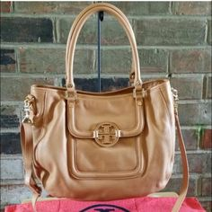 Authentic Tory Burch Amanda Hobo Beautiful Tory Burch Amanda Hobo bag with original tag and shopping bag! So beautiful and in great condition! I originally bought this on posh and loved this bag - the first photo is from the original listing because who doesn't love that brick background!?  No trades or PayPal please! Tory Burch Bags Hobos