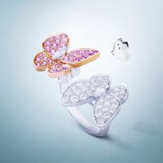Van Cleef & Arpels Two Butterfly Between the Finger Ring set in white and pink gold with diamonds and pink sapphires