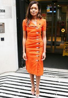 Naomie Harris wears an orange Altuzarra linen midi dress with nude strappy sandals