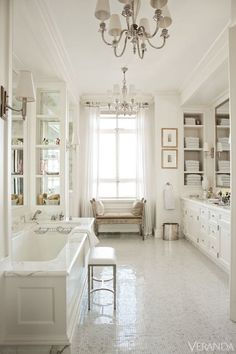 All white master bathroom with great storage