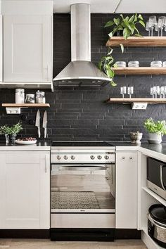 Are you considering a kitchen makeover?  Black tile in kitchens is a new trend that we love. Black tile in the kitchen can be super shiny or moody matte. Whether you are doing a kitchen makeover or just updating Black tile in the kitchen is the way to go. Keep reading as we share The ultimate guide to using black tile in your kitchen. Hadley Court Interior Design Blog by Central Texas Interior Designer, Leslie Hendrix Wood.