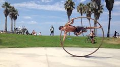 Cyr Wheel Venice Beach .... want to try this just once, until I squish my fingers...