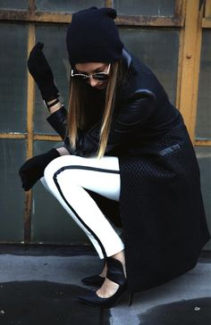 Fall / Winter Fashion White Skinny Jeans , Black Pumps, Beanie , Leather Coat, White Sweater, Black Gloves