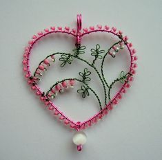 Inspired by my newly flowering Dicentra.  Craft wire, seed beads and a cats eye bead.  Not the greatest pic - tried to catch the last of the evening light, not entirely successfully! ;)