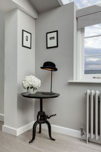 We loved the crank table and bowler hat lamp our interior designer proposed.  We got the artwork in Greenwich Village.