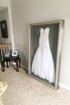 Instead of putting my wedding dress in a box hidden in the attic or possibly sel. Instead of putting my wedding dress in a box hidden in the attic or possibly selling it, I had it shadow boxed to di Wedding Dress Frame, Wedding Dress Display, Wedding Dresses, Wedding Dress Storage, Wedding Picture Frames, After Wedding Dress, Wedding Goals, Our Wedding, Wedding Planning