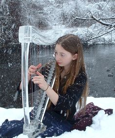 Lucite electric harp in the snow (electricharp.com)