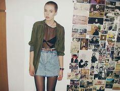 90s grunge - acid wash denim skirt, khaki shirt, sheer top and shaved head