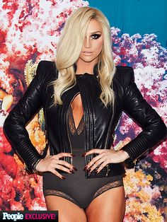 KE$HA in body suit and leather jacket