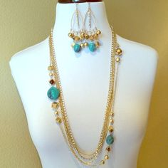 Gold n Turquoise Statement Necklace Set Simply Stunning Set you'll love the style.  necklace comes with earrings.  I can already picture you walking on a beach wearing these bad boys or somewhere on a cruise getting ready for your next adventure.  The necklace has a variety of styled chains and one with crystals.  Necklace is approx. 35 in. long & earrings are approx 3.5 in. long. This set is light weight & made of good quality.  earrings have crystals for that rich feel to it.  If you need…