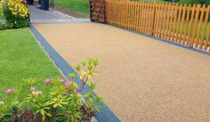 Here we have a resin driveway it is a lovely finish to the entrance to your home.