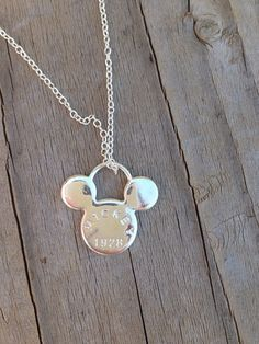 This adorable Mickey necklace is a simple piece to express your Disney side. It features a mouse shaped charm with geometric designs on the