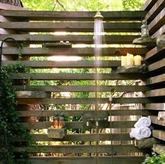 Outdoor Shower slat wall with rock inserts to hold soap, shampoo