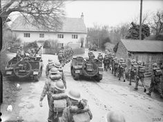 Infantry and Bren gun carriers of the Battalion Northamptonshire Regiment pass through a village during Division exercises near Christchurch in Dorset, March 1941 Ww2 Pictures, Ww2 Photos, Military Pictures, Special Air Service, British Army Uniform, Magna Carta, Ww2 Tanks, Battle Of Britain, Military Diorama