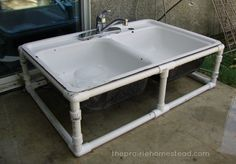 Turn the old kitchen sink into an outside water bowl station for the dawgs.  Just make a PVC frame to fit the sink.......D.