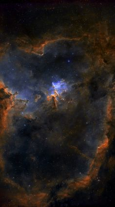 Located about 7,500 light years away toward the constellation of Cassiopeia, the large emission nebula IC 1805 glows brightly in red light emitted by its most prominent element: hydrogen. The red glow and the larger shape are all created by a small group of stars near the nebula's center. In the center are young stars from the open star cluster Melotte 15 that are eroding away several dust pillars with their energetic light and winds. (NASA APOD).