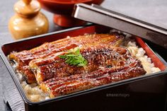 Unaju (broiled eel served over rice a lacquered box)