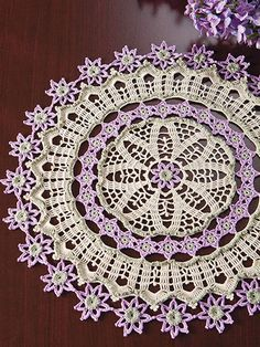 "This exquisite doily adorned with sweet little flowers will make a gracious statement of elegance wherever it's displayed. This e-pattern was originally published in Crochet World magazine's special publication Joy of Thread. Size: 15"" in diameter. Made with size 20 crochet cotton and size 9/1.25mm steel hook. Skill Level: Intermediate"