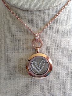 Simple and classic, my style.  Me simul rosé gold locket, 2mm rose gold chain, new rosé gold clasp and medium heart window plate. http://www.dinaanderson.origamiowl.com