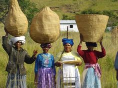 Zhosa baskets made by these women from grass and reeds.