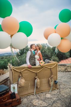 Okay I know its from a wedding photo but the hot air balloon idea is cute with the balloons. I like the green, peach and white color combo.