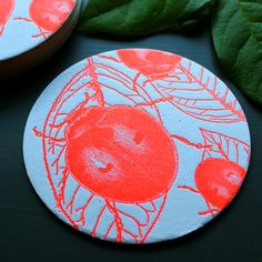 A fluorescent red ladybug coaster for luck! Sold in a set with 3 other letterpress bug coasters from Sesame Letterpress.