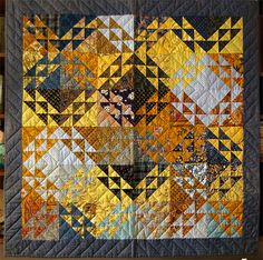 Quilts - Variation on the Nine patch quilt and triangles